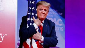 Mr. Trump hugs the flag